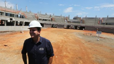 Rio Mayor Eduardo Paes inspects construction work at the Olympic Park's Tennis Centre in December..