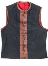 Demons jumper, 1900. Melbourne jumpers were made of sturdy blue linen, with a red leather strip hen down the front with eyelets and lacing.