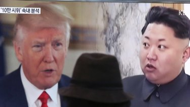 A man watches a television screen showing U.S. President Donald Trump, left, and North Korean leader Kim Jong-un during a news program at the Seoul Train Station in Seoul, South Korea.