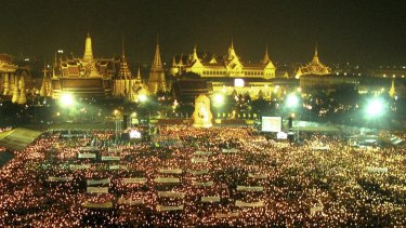 Thai people outside the Grand Palace as part of the King's 80th birthday celebrations in 2007.