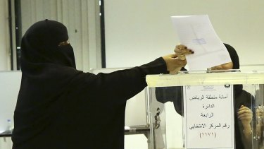 Saudi women vote at a polling centre during municipal elections in Riyadh last year.