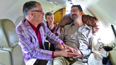 """I now pronounce you husband and husband,"" said officiant Paulette Roberts as Jim Obergefell, left, and John Arthur are married on the tarmac of Signature Flight Support at Baltimore/Washington International Thurgood Marshall Airport."