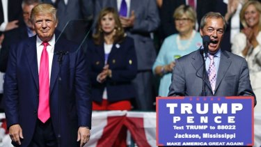 Nigel Farage, ex-leader of the British UKIP party, speaks as Republican presidential candidate Donald Trump, left, listens, at Trump's campaign rally in Jackson, Mississippi.