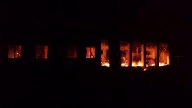 The hospital ablaze.