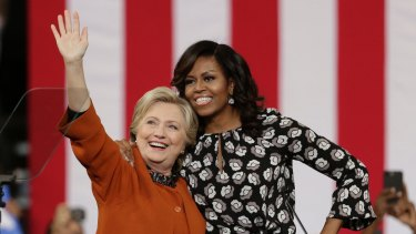 Hillary Clinton with first lady Michelle Obama at a rally in North Carolina.