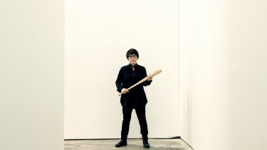 Artist Mami Kataoka had a practice swing of the bat on Friday.