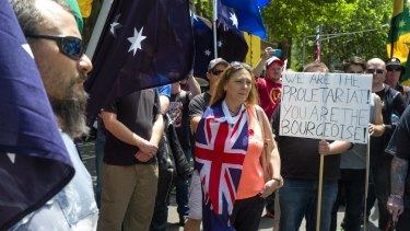 Members of the United Patriot Front attend a rally at State Parliament