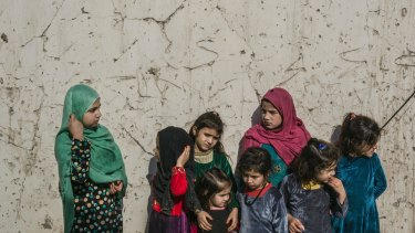 Meena, 11, left, with other children who live in the women's wing of the Nangarhar provincial prison, in Jalalabad, Afghanistan.