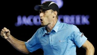 Australian No. 3: John Millman in action against Bernard Tomic at the Australian Open.