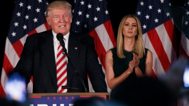 Ivanka Trump listens as her father delivers a policy speech.