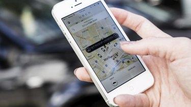 Checking the Uber app.