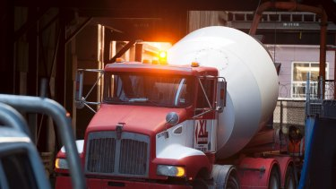 A cement truck delivering cement to a building site in the Melbourne CBD.