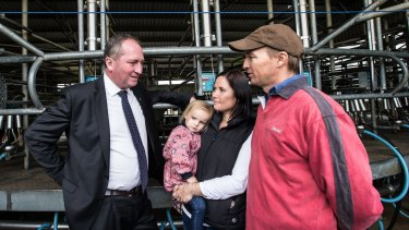 Barnaby Joyce talks with dairy farmer Ashley Galt and his wife Lucy Galt in May.