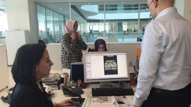 Editors at <i>Today's Zaman</i> newspaper in Turkey prepare for publication just before a police raid on the night of March 4. Editor-in-chief Sevgi Akarcesme is at left.