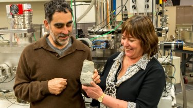 Professor Allen Nutman (left) of the University of Wollongong and Professor Vickie Bennett of the Australian National University with some of the rock evidence of 3.7-billion-year-old stromatolite fossils.