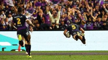 Melbourne's Josh Addo-Carr scores in the grand final.