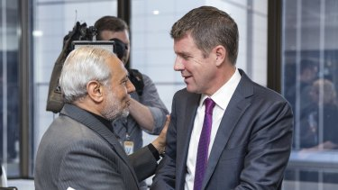 Mike Baird is greeted by Grand Mufti of Australia Dr Ibrahim Abu Mohammed at a meeting with Muslim community leaders to discuss countering violent extremism.