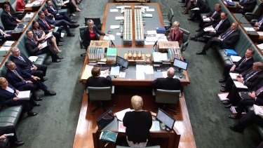 Speaker Julie Bishop addresess the House as Acting Prime Minister Julie Bishop and Acting Opposition Leader Tanya Plibersek sit at the table during question time on December 3.