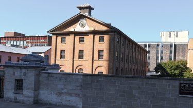 The Hyde Park Barracks on Macquarie Street, with buildings to be demolished at rear.