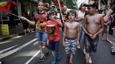 Aborginal children at a a Human Rights Day protest in Sydney.
