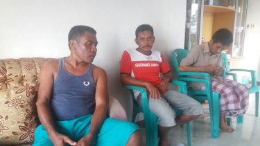 Three fishermen who helped return six Bangladeshi asylum-seekers and two alleged people smugglers to Indonesia. Gab Oma 39, left, Muhammad Hatta 35, centre, Hamzah, 29, right.