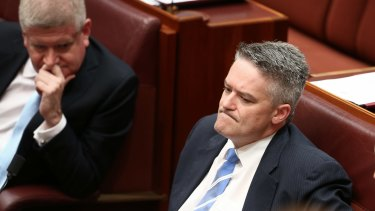 Australia Post shareholder Ministers Mitch Fifield (left) and Mathias Cormann.