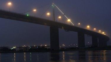 Evening fog closes in on the West Gate Bridge, Melbourne.