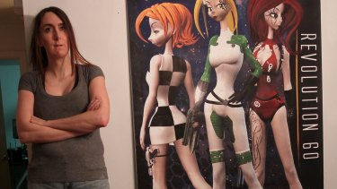 Game developer Brianna Wu with art from <i>Revolution 60</i>, the debut game from the studio she co-founded.