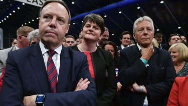 DUP Deputy Leader and North Belfast candidate Nigel Dodds, DUP Leader Arlene Foster and former DUP leader and Northern Ireland First Minister Peter Robinson watch the Belfast count on Thursday night.