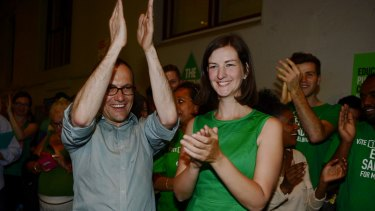 The federal member for Melbourne Adam Bandt celebrates the election of new state member for Melbourne Ellen Sandell in 2014.