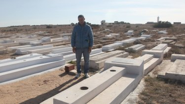 Lotfi Bouazizi, 35, at his famous cousin Mohamed's grave in Sidi Bouzid. Lotfi was in Italy searching for work when his cousin's suicide sparked the Arab Spring. He returned in the hope that the Jasmine Revolution would improve life in Tunisia.