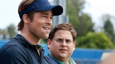 Brad Pitt as Billy Beane and Jonah Hill as Peter Brand in 2011 movie <i>Moneyball</i>. Brand is the fictionalised version of the assistant who pioneered the data-driven approach to player selection for the Oakland A's.
