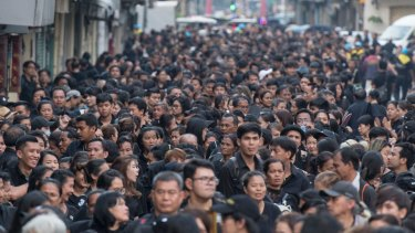 Thai mourners line up ahead of the Royal Cremation ceremony in Bangkok on Wednesday.