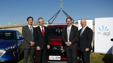 Mitsubishi CEO Mutsuhito Oshikiri, Minister for Urban Infrastructure Paul Fletcher, Minister for Environment and Energy Josh Frydenberg and AGL CEO Andy Vesy during an electric car event on the front lawn of Parliament House in Canberra on Monday 22 May 2017. fedpol Photo: Alex Ellinghausen