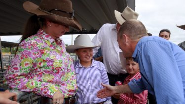 Premier Campbell Newman greets some young locals.
