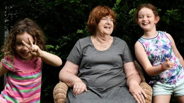 Irene Smith, a former teacher, with her two grandaughters Abby, 5, and Poppy, 9, at her Artarmon home.