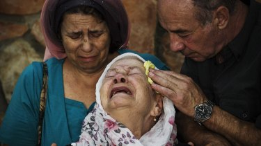 The mother of Albert Alon Govberg, who was shot dead in an attack on a bus, at his funeral in Jerusalem on Wednesday.