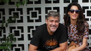 """""""How can one man be so lucky?"""" says George Clooney, pictured here with UN lawyer, his wife Amal."""