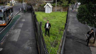 Mike Flattley, Royal Society of Victoria executive director, and the vacant patch of land.