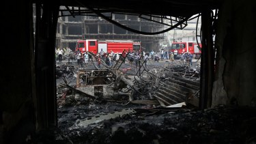 The aftermath on Sunday of a car bomb in Karada, a busy shopping district in the centre of Baghdad.
