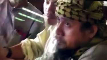 An image taken from video of the purported leader of Islamic State's south-east Asian branch, Isnilon Hapilon, at a meeting of militants at an undisclosed location.