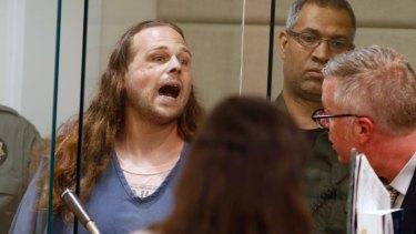 Jeremy Joseph Christian shouts as he is arraigned in Multnomah County Circuit Court in Portland, Oregon.