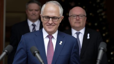 Finance Minister Mathias Cormann, Prime Minister Malcolm Turnbull and Attorney-General George Brandis at Parliament House in Canberra on Tuesday.
