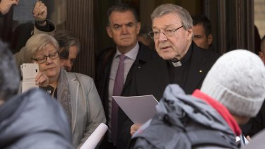 Cardinal George Pell reads a statement to reporters as he leaves the Quirinale hotel after meeting with survivors of sex abuse.