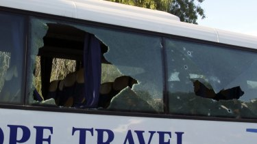 A damaged bus is seen after the attack.