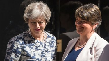 Britain's Prime Minister Theresa May outside 10 Downing Street with DUP leader Arlene Foster.