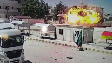 An explosion is captured on CCTV after a car bomb detonated in Kobane.