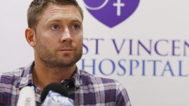 Dark day: An emotional Michael Clarke at the press conference following Phillip Hughes' death on Thursday.
