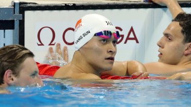 China's Sun Yang, centre, looks up after winning the silver medal.