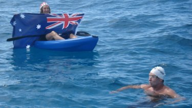A fan displays an Australian flag during Pete Tanham's 2014 Rottnest Swim.